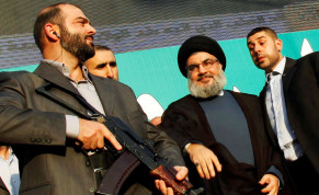 Lebanon's Hezbollah leader Sayyed Hassan Nasrallah, escorted by his bodyguards, greets his supporters at an anti-US protest in Beirut's southern suburbs, Lebanon September 17, 2012