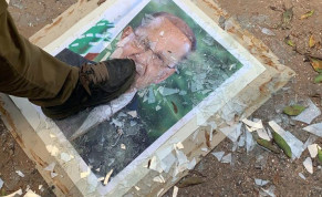 A demonstrator steps on a picture of Lebanese President Michel Aoun, at the Ministry of Foreign Affairs during a protest following Tuesday's blast, in Beirut, Lebanon August 8, 2020