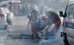 Rescuers assist demonstrators during a protest, following Tuesday's blast, in Beirut, Lebanon August 8, 2020