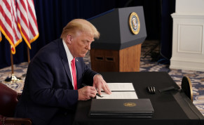US President Donald Trump signs executive orders for economic relief at his golf resort in Bedminster, New Jersey, US, August 8, 2020.