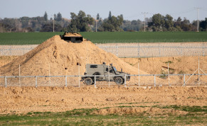An Israeli military vehicle is seen at the Israel-Gaza border fence in the southern Gaza Strip, February 28, 2020
