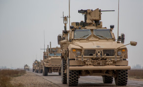 A Coalition convoy of US led international coalition against ISIS stops to test fire their M2 machine guns and MK19 grenade launcher in the Middle Euphrates River Valley in the Deir Ezzor province, Syria, November 22, 2018