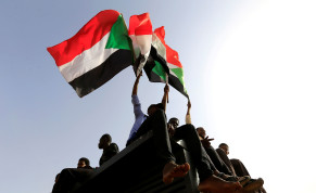 Sudanese protesters shout slogans and wave flags during a rally honouring fallen protesters at the Green Square in Khartoum, Sudan July 18, 2019
