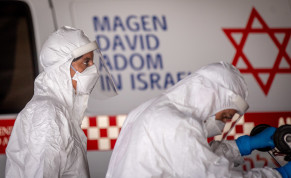 Magen David Adom workers wearing protective clothing seen outside the coronavirus unit at Shaare Zedek Medical Center, Jerusalem, September 6, 2020