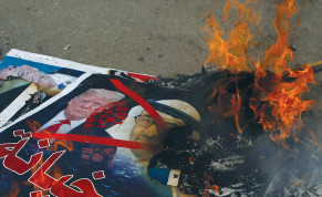 PICTURES DEPICTING Prime Minister Benjamin Netanyahu, US President Donald Trump and Abu Dhabi Crown Prince Mohammed bin Zayed al-Nahyan are burned by Palestinians during a protest against the United Arab Emirates' and Bahrain's deals with Israel to normalize relations, in Gaza City, Tuesday.
