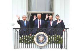 PRIME MINISTER Benjamin Netanyahu, US President Donald Trump, Bahrain's Foreign Minister Abdullatif Al Zayani and United Arab Emirates (UAE) Foreign Minister Abdullah bin Zayed wave from the White House balcony on Tuesday.