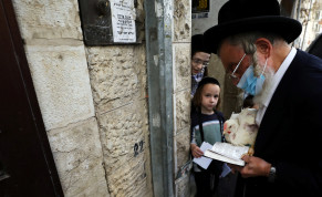 Boys watch as an ultra-Orthodox Jewish man performs the Kaparot ritual, where white chickens are slaughtered as a symbolic gesture of atonement, ahead of Yom Kippur, the Jewish Day of Atonement, as Israel is set to tighten its second nationwide coronavirus disease (COVID-19) lockdown amid a rise in