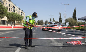 Police set up a checkpoint in Jerusalem as Israel enters its second coronavirus lockdown