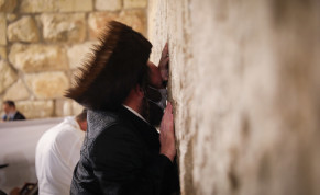 An ultra-Orthodox (haredi) man prepares for Yom Kippur, praying at the Western Wall in Jerusalem's Old City, September 26, 2020