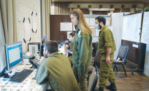 HOME FRONT Command soldiers work at the Dan Hotel in Jerusalem in April, after it was turned into a quarantine facility.