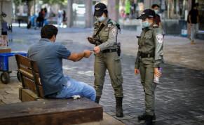 Israel Police officers check citizen's identification to keep coronavirus restricions, Jerusalem