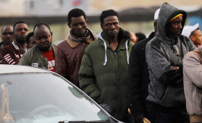 African migrants wait in line for the opening of the Population and Immigration Authority office in Bnei Brak, Israel February 4, 2018