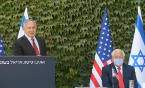 Prime Minister Benjamin Netanyahu and US Ambassador to Israel David Friedman are seen at a ceremony at Ariel University.