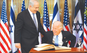 Prime Minister Benjamin Netanyahu laughs with then-vice president Joe Biden after he signed the guest book at the Prime Minister's Residence in Jerusalem on March 9, 2010