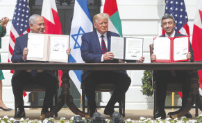 PRIME MINISTER Benjamin Netanyahu, US President Donald Trump and United Arab Emirates Foreign Minister Abdullah bin Zayed display their copies of signed agreements normalizing relations between Israel and the UAE, in Washington, in September.