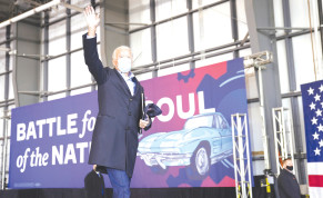 Joe Biden salutes supporters next to the slogan 'Battle for the soul of the nation' during a pre-election event in Cleveland, Ohio, on November 2.