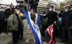 Protesters burn the US and Israeli flags during a demonstration against the the killing of Mohsen Fakhrizadeh, Iran's top nuclear scientist, in Tehran, Iran, November 28, 2020.