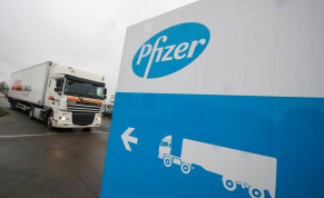 A refrigerated truck leaves the Pfizer plant in Puurs, Belgium December 3, 2020.