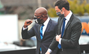 Newly-elected Georgia Senators Rev. Raphael Warnock and Jon Ossoff appear side by side ahead of the January 5 runoff election.