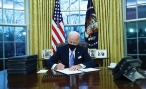 US PRESIDENT Joe Biden signs executive orders in the Oval Office of the White House on Wednesday, after his inauguration as the 46th president of the United States.