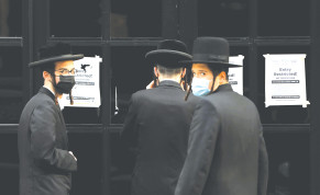 HAREDIM GATHER near the Congregation Yetev Lev D'Satmar synagogue in the South Williamsburg neighborhood of Brooklyn, last year.