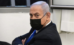 Israeli Prime Minister Benjamin Netanyahu looks on before the start of a hearing in his corruption trial at Jerusalem's District Court February 8, 2021
