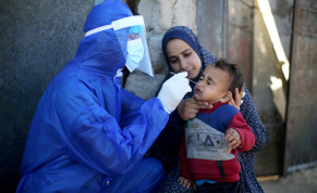 Palestinian medical worker collects a swab sample from a boy to be tested for the coronavirus disease (COVID-19), in the southern Gaza Strip January 14, 2021.