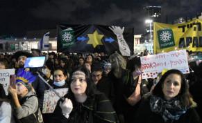 Coronavirus deniers protest the COVID-19 vaccine and the green passport program near HaBima Theater in Tel Aviv, Feb. 24, 2021.