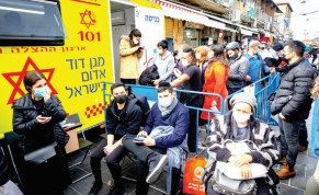 PEOPLE WAIT to receive their COVID-19 vaccine injections outside a mobile Magen David Station at the Mahaneh Yehuda market in Jerusalem, on Monday.