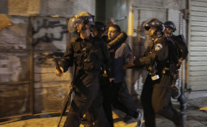 Israeli police officers detain a Palestinian suspected of throwing stones during clashes outside Jerusalem's Old City