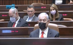 A screenshot shows New Hope leader Gideon Sa'ar winking behind Prime Minister Benjamin Netanyahu in the Knesset on April 19, 2021.