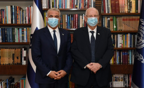 Yesh Atid leader Yair Lapid (L) pictured next to President Reuven Rivlin