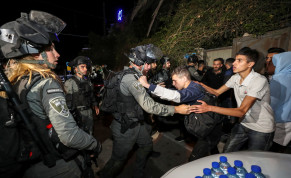 An Israeli border policeman scuffles with a Palestinian protester during clashes amid ongoing tension ahead of an upcoming court hearing in an Israeli-Palestinian land-ownership dispute in the Sheikh Jarrah neighbourhood of East Jerusalem May 3, 2021.