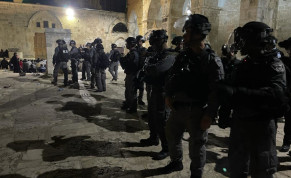 Border Police officers clash with worshipers at the Temple Mount, Friday, May 7, 2021.