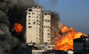 Smoke and flames rise from a tower building as it is destroyed by Israeli air strikes amid a flare-up of Israeli-Palestinian violence, in Gaza City May 12, 2021. Mustafa