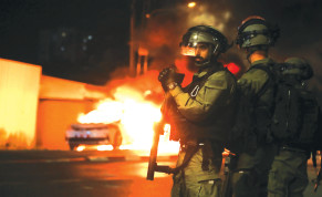 This is Hamas's victory image. Policemen stand near a burning police car during clashes with Arab rioters in the Arab-Jewish town of Lod this week.