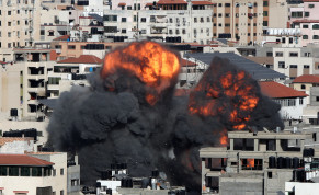 Smoke and flames rise during an Israeli air strike, amid a flare-up of Israeli-Palestinian violence, in Gaza City May 14, 2021.
