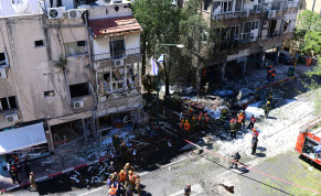 Police and rescue personnel at the site hit by a rocket fired from the Gaza Strip, in Ramat Gan, on May 15, 2021.