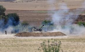n IDF artillery unit fires towards Gaza Strip near the Israel-Gaza border in Southern Israel, May 18, 2021.