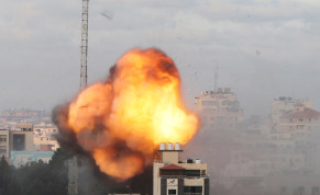 Smoke and flames are seen following an Israeli air strike on a building, amid a flare-up of Israeli-Palestinian fighting, in Gaza City May 18, 2021.