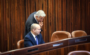 Yamina head Naftali Bennett and Yesh Atid head Yair Lapid in the Knesset Plenum during June 2, 2021 presidential elections.