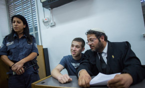 Yitzhak Gabai (C), a member of the right-wing Lehava organization at the courtroom of the District Court in Jerusalem as he arrives to a court hearing on July 22, 2015, Yitzhak Gabai where involved in the arson attack on a Jewish-Arab school in Jerusalem on November 29, 2014.