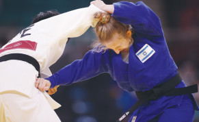 ISRAELI JUDOKA Shira Rishony competes against Taiwan's Lin Chen-hao, forced to wear the TPE tag for Chinese Taipei.