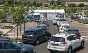 ISRAELI MOTORISTS line up at a drive-through COVID-19 test complex in Modi'in, last week.