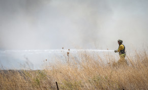Israeli security seen at the scene of where a missile fired from Lebanon, into Northern israel, hit in an open field, near the city of Kiryat Shmona, August 4, 2021.