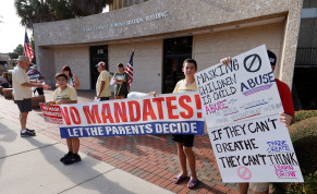 Residents demonstrate before the Lake County School Board started an emergency meeting to discuss mask mandates to prevent the spread of coronavirus disease (COVID-19) in Tavares, Florida, US, September 2, 2021.