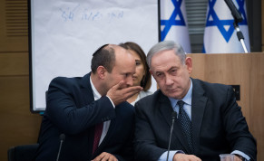 Then prime minister Benjamin Netanyahu speaks with then minister of Defense and leader of the Yamina party Naftali Bennett, March 4, 2020.