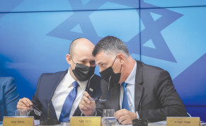 PRIME MINISTER Naftali Bennett and Justice Minister Gideon Sa'ar participate in a press conference in Jerusalem in July.