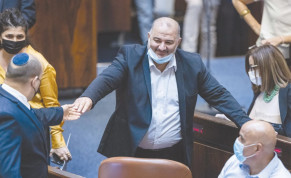 PRIME MINISTER Naftali Bennett and MK Mansour Abbas in the Knesset. This week, various members of the coalition – foremost Abbas's Ra'am party – signaled that they may not vote for the budget if certain conditions were not met.