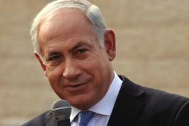 Bibi smiling and pointing 311 ap (photo credit: Associated Press)
